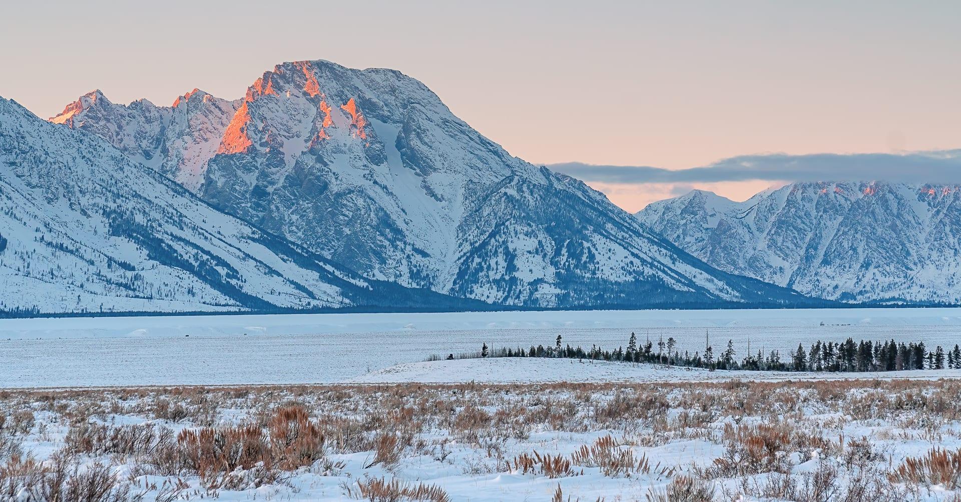 Frozen Jackson Lake and Mount Moran in winter at sunset