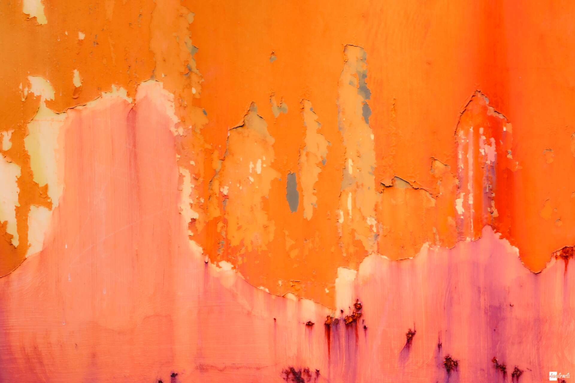 abstract peeling paint image that looks like monument valley at sunset